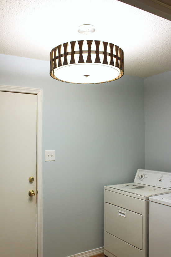 Light Fixture Hanging Above Washer and Dryer