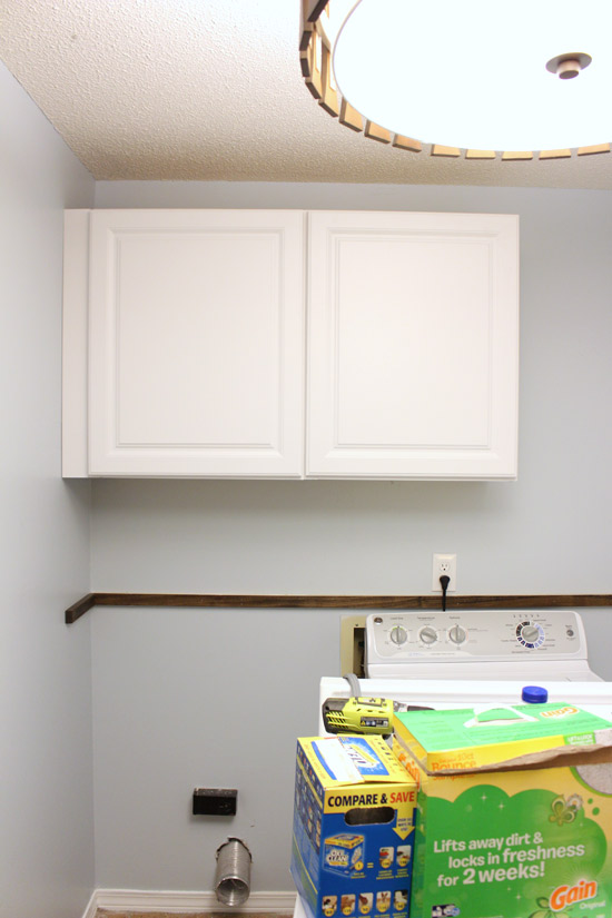 cabinets hung in place in laundry room