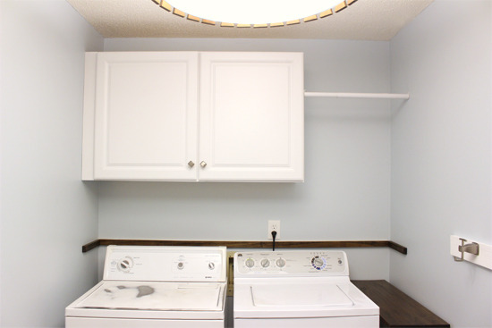 cabinets on wall above washer and dryer