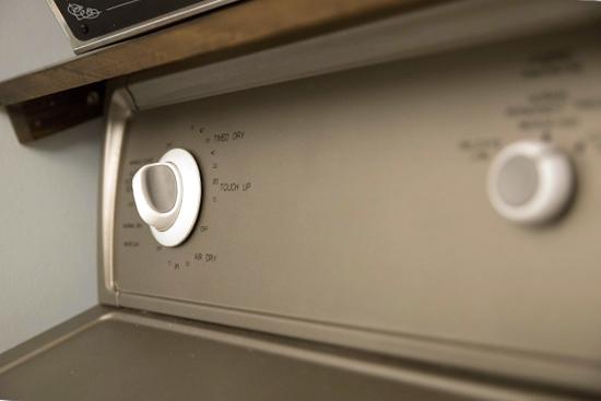 black vinyl lettering on dryer control panel