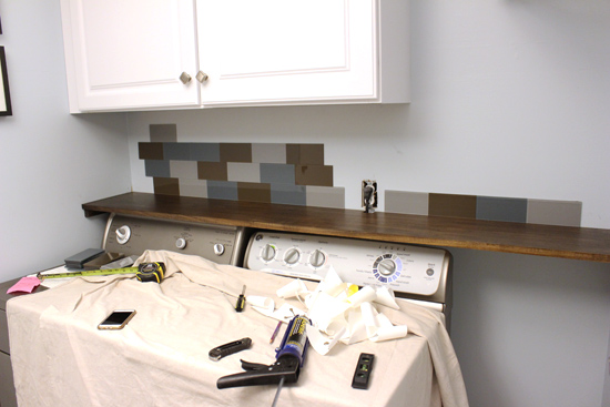 Progress on Backsplash Tile Above Washer and Dryer