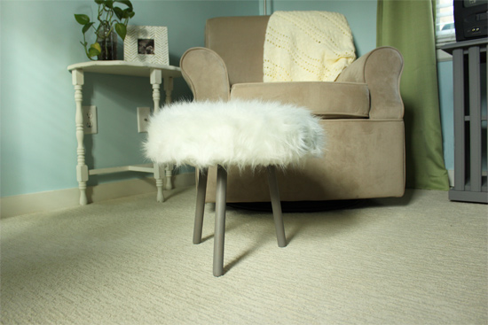 Fur Footstool in Front of Tan Glider Rocking Chair
