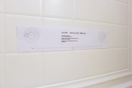 template taped to shower wall