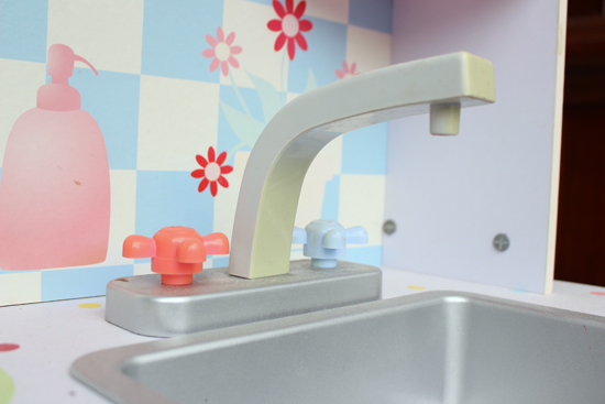 Sun Damaged Faucet On Play Kitchen