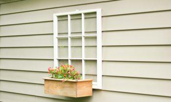 Upcycle wood window into Backyard Decor on tan vinyl garage wall