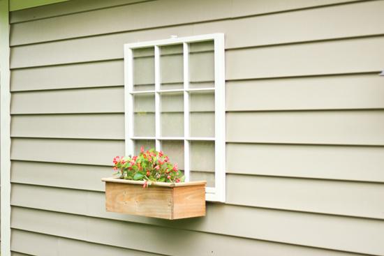 Wooden Window Hanging on Outside of Garage