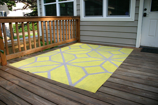 Painted Outdoor Rug On Wood Deck