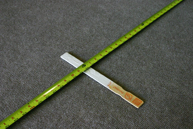 Using Paint Stirrer to Mark Rug Design