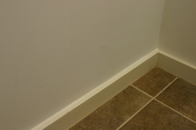 Caulking Baseboard in Laundry Room Before Painting