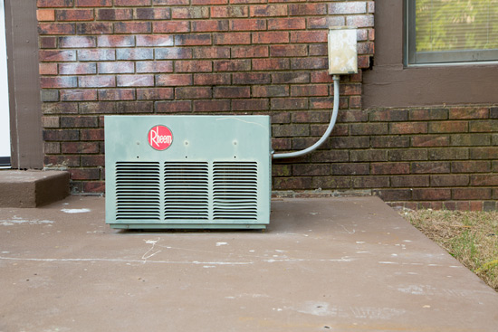 Small Air Conditioning Unit Sitting on Concrete Slab Patio