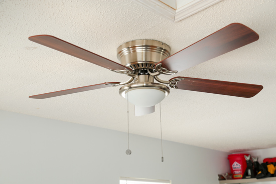 Ceiling Fan Installed Over Weight Bench in Garage