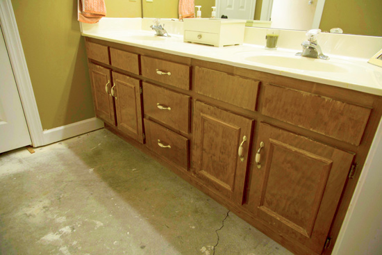 Stained Wood Bathroom Vanity with Concrete Floors