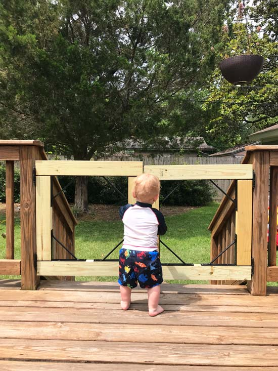 Toddler Boy Helping Momma Build Gate for Summer