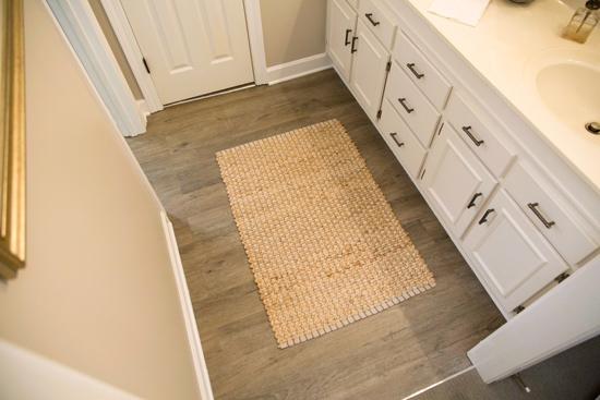 Vanity Area with Gray Vinyl Plank Floor and Sisal Rug