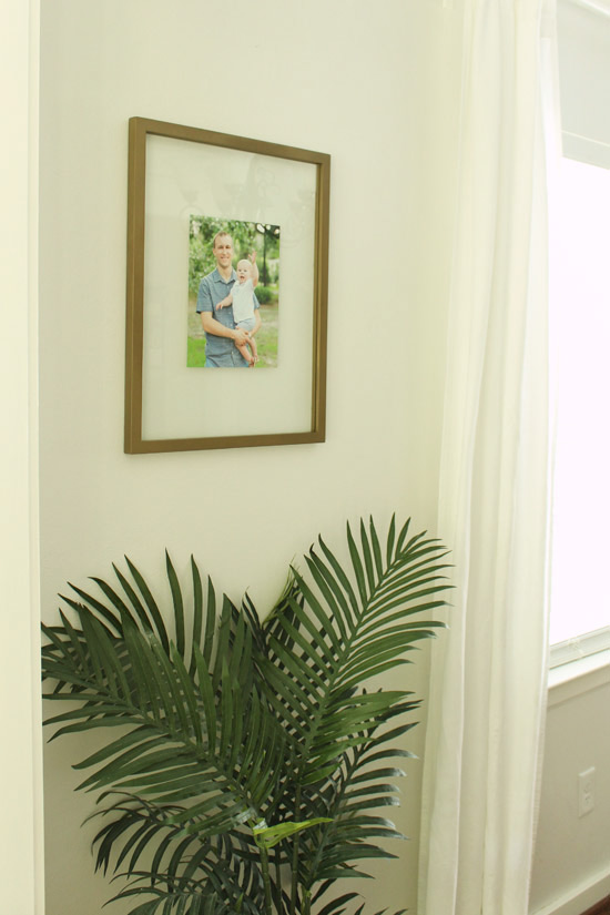 New Frames Hanging in Dining Room with Family Portraits