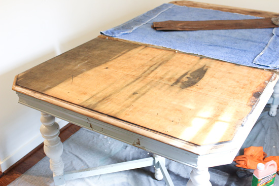 One Side of Dining Table with Veneer Layer Stripped