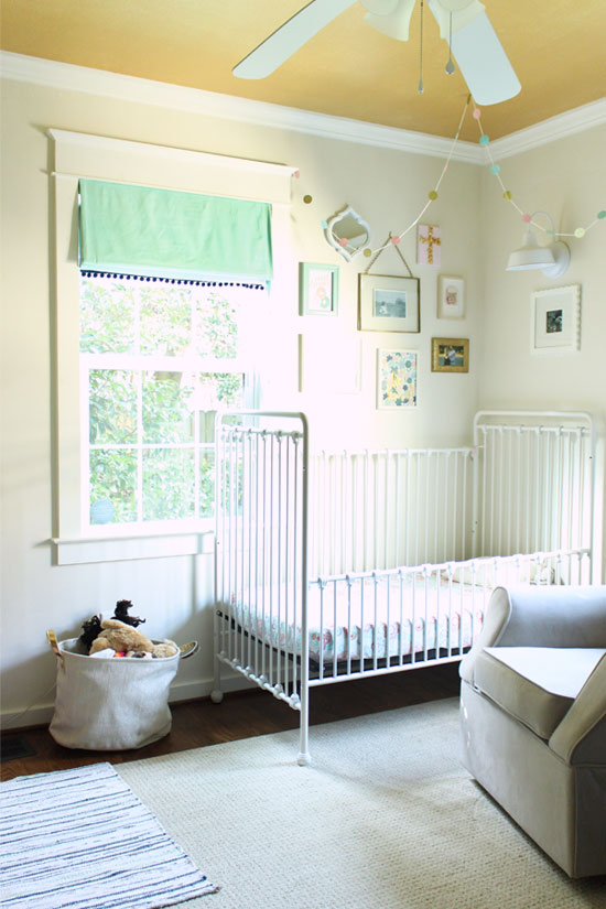Kids' Shared Bedroom with White Walls and Gold Ceiling