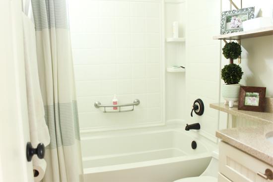 White Shower Tub Combo Kit Installed in Hallway Bathroom