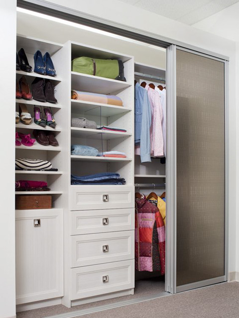Closet with Frosted Glass Bypass Sliding Doors