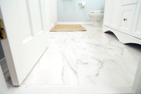 Installing Tile Over Tile in Small Hall Bath