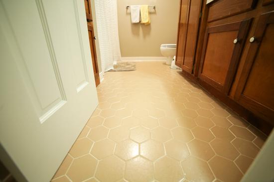 Tan Hexagon Tiles on Floor of Bathroom