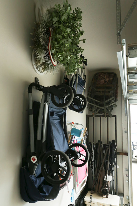 Using Wall Hooks to Store Stroller and Hunting Gear