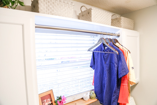 Clothes Rack Between Cabinets in Laundry After Facelift