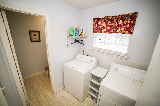 Dated Laundry Room with Door into Bathroom