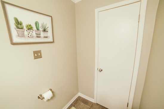 Door Relocated in Small Bathroom for Better Access
