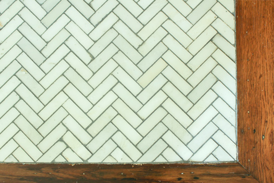Marble Herringbone Tile with Painted Grout Upgrade