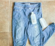 Denim Pants with Latex Paint on Them on Tile Floor with Rubbing Alcohol and Scrub Brush