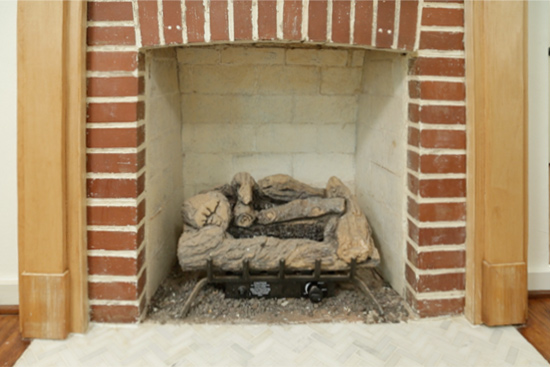 Fireplace with Red Bricks and Dingy White Firebox Before Painting