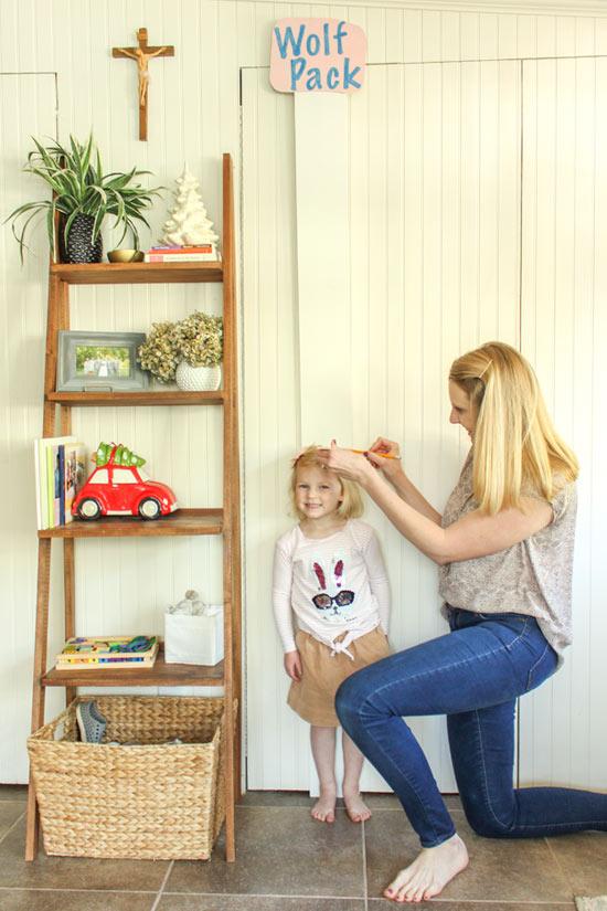 Marking Toddlers Height on Keepsake Chart