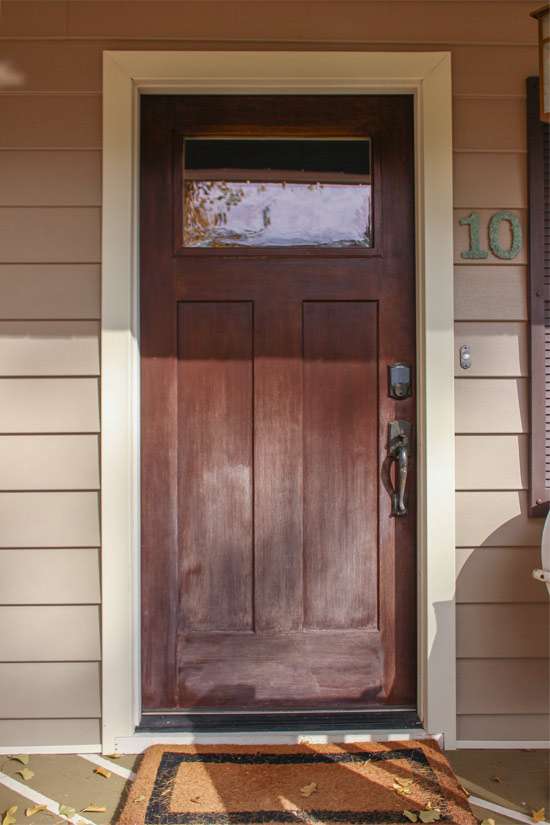 Stained Wood Front Door Faded from Sun Exposure
