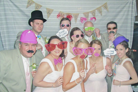 Bridal Party Posing for Photo Booth at Wedding Reception