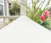 2x6 White Painted Handrail on Front Porch with Pink Flowers in Planter Box