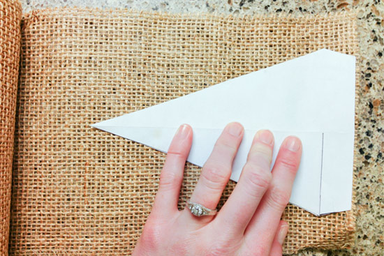 Laying Paper Template on Roll of Burlap for Tracing