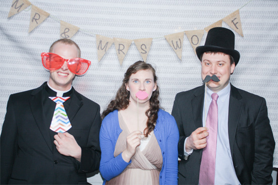 Wedding Guests in Front of Photo Booth Bunting Background