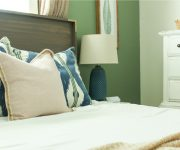 Wood Queen Headboard with White Duvet Navy Green Pillows