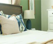 Wood Queen Headboard with White Duvet Navy Green Pillows