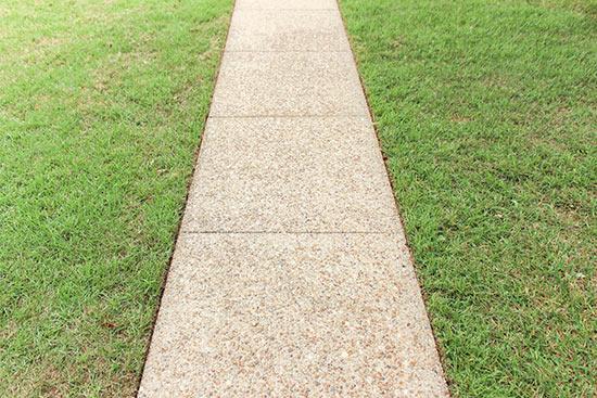 Freshly Edged Concrete Sidewalk with Green Grass