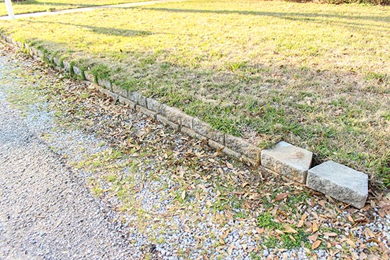 Overgrown Retaining Wall in Front Yard