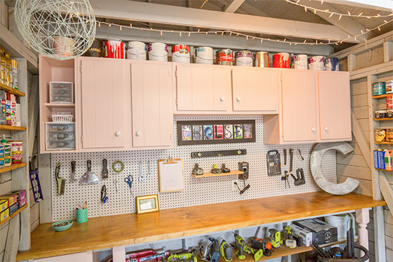 Pink Cabinets in Workshop with White Pegboard