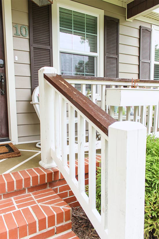 Stained Front Porch Handrails After Pressure Washing