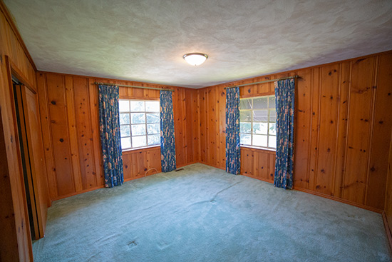 Pine Paneling Bedroom with Navy Curtains