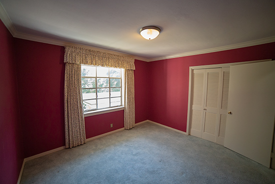 Dark Pink Child Bedroom with Bi-Fold Closet Doors