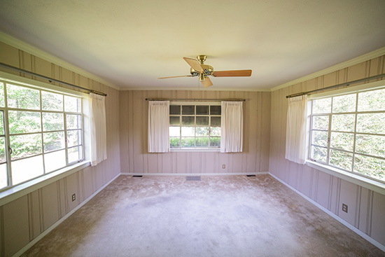 Painted Paneling Room with Large Windows and Drapes