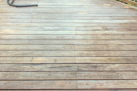 Dingy Wood Deck After Pressure Washing