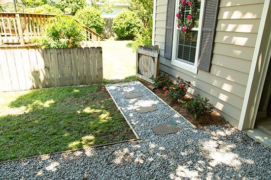 Gravel Walkway Ties Driveway Into Backyard