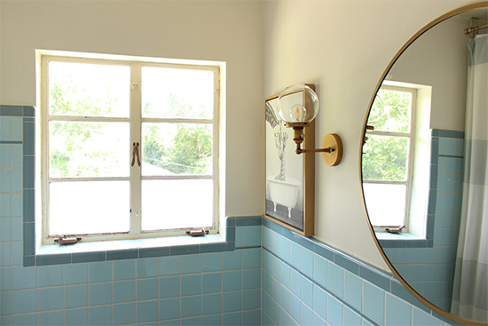 Brass Mirror and Sconces with Casement Windows